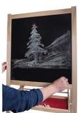Árbol de navidad dibujado en tiza de pizarra sin la inscripción Fotos de archivo