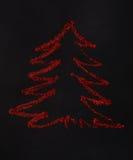 Árbol de navidad El brillo rojo se separó en fondo negro, abstracto Foto de archivo