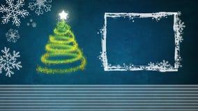 Árbol de navidad en el fondo azul con el freame blanco Fotografía de archivo