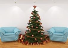 Árbol de navidad en el interior con las sillas azules Fotos de archivo libres de regalías