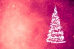 Árbol de navidad en fondo púrpura Fotos de archivo