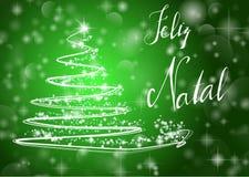 Árbol de navidad en fondo verde brillante con la escritura Fotos de archivo