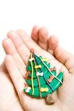 Árbol de navidad en manos imágenes de archivo libres de regalías
