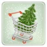 Árbol de navidad en un carro de la compra Imágenes de archivo libres de regalías