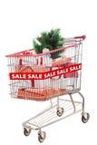Árbol de navidad en venta en el carro de compras aislado Imagenes de archivo