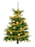 Árbol de navidad enorme con las chucherías del oro fotografía de archivo libre de regalías