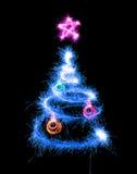 Árbol de navidad hecho por la bengala en un negro Imágenes de archivo libres de regalías