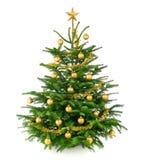 Árbol de navidad hermoso con las chucherías del oro Fotografía de archivo