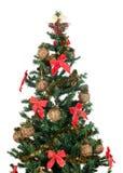 Árbol de navidad hermoso con las cintas y el oro rojos Fotografía de archivo libre de regalías