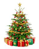 Árbol de navidad magnífico con las cajas de regalo foto de archivo