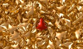 Árbol de navidad rojo en un fondo del oro Fotos de archivo libres de regalías