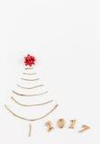 Árbol de navidad simple en blanco - tarjeta original del Año Nuevo Imagen de archivo libre de regalías