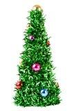 Árbol de navidad sintético con las bolas coloreadas en ramas Imagen de archivo