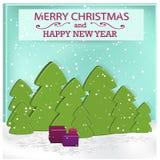 Árbol de navidad y cajas verdes con los regalos Foto de archivo