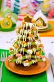 Árbol de navidad y casa del pan de jengibre Fotos de archivo libres de regalías