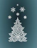 Árbol de navidad y copos de nieve de papel Fotografía de archivo