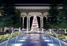 Árbol de navidad y fuente Foto de archivo libre de regalías