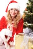 Árbol de navidad y muchacha de santa Fotografía de archivo