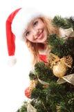 Árbol de navidad y muchacha de santa Imágenes de archivo libres de regalías