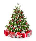 Árbol de navidad y regalos, en rojo y plata fotos de archivo