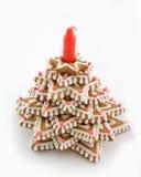 Árbol del pan de jengibre con la vela Imágenes de archivo libres de regalías