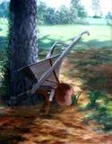 Árbol e instrumento viejo de la granja Fotografía de archivo