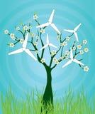 árbol floreciente con los molinoes de viento Imagenes de archivo