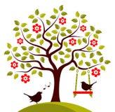 Árbol floreciente y pájaros Imagen de archivo libre de regalías