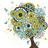 Árbol que reparte con los flores Imagen de archivo