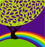 Árbol y arco iris. Foto de archivo