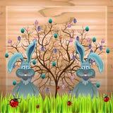 Árbol y conejos Fotos de archivo