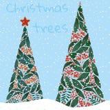 Árboles de navidad con el fondo de Navidad de la nieve Foto de archivo libre de regalías