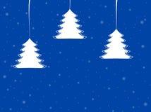 Árboles de Navidad con los copos de nieve blancos Imagen de archivo