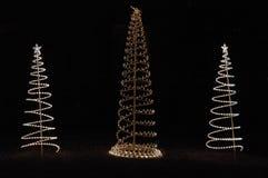 Árboles de navidad en luces Fotos de archivo libres de regalías