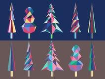 Árboles de navidad poligonales brillantes Imagenes de archivo
