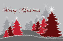 Árboles de navidad rojos Imagen de archivo