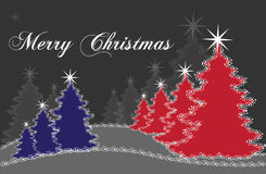 Árboles de navidad rojos y azules Fotos de archivo libres de regalías