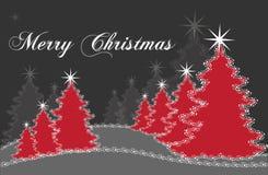 Árboles de navidad rojos y grises Imagenes de archivo