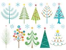 Árboles de navidad y copos de nieve Fotos de archivo