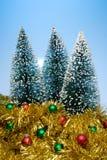 Árboles de navidad y oropel Imágenes de archivo libres de regalías