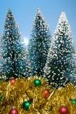 Árboles de navidad y oropel Foto de archivo libre de regalías
