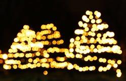 Árboles del Año Nuevo de luces del bokeh Fotos de archivo libres de regalías