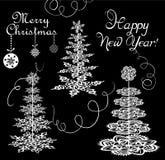Árboles del papel de Navidad con los copos de nieve Fotografía de archivo libre de regalías