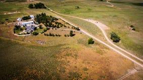Área cultivada e casa Imagem de Stock Royalty Free