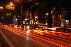 Área de funcionamento no tráfego na noite Fotografia de Stock Royalty Free
