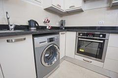 Área de la cocina en el apartamento de lujo Foto de archivo
