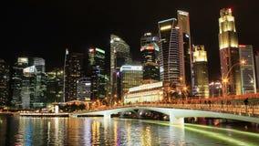 Área de time lapse de Marina Bay del paisaje urbano en la noche, ciudad Asia de Singapur almacen de metraje de vídeo