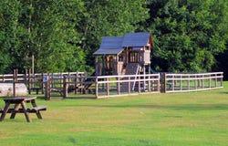 Área del juego de madera de los niños Foto de archivo libre de regalías