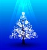 Árvore da neve sob a luz  Imagem de Stock Royalty Free