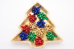 A árvore de abeto deu forma ao prato da porcelana com curvas coloridas Imagem de Stock